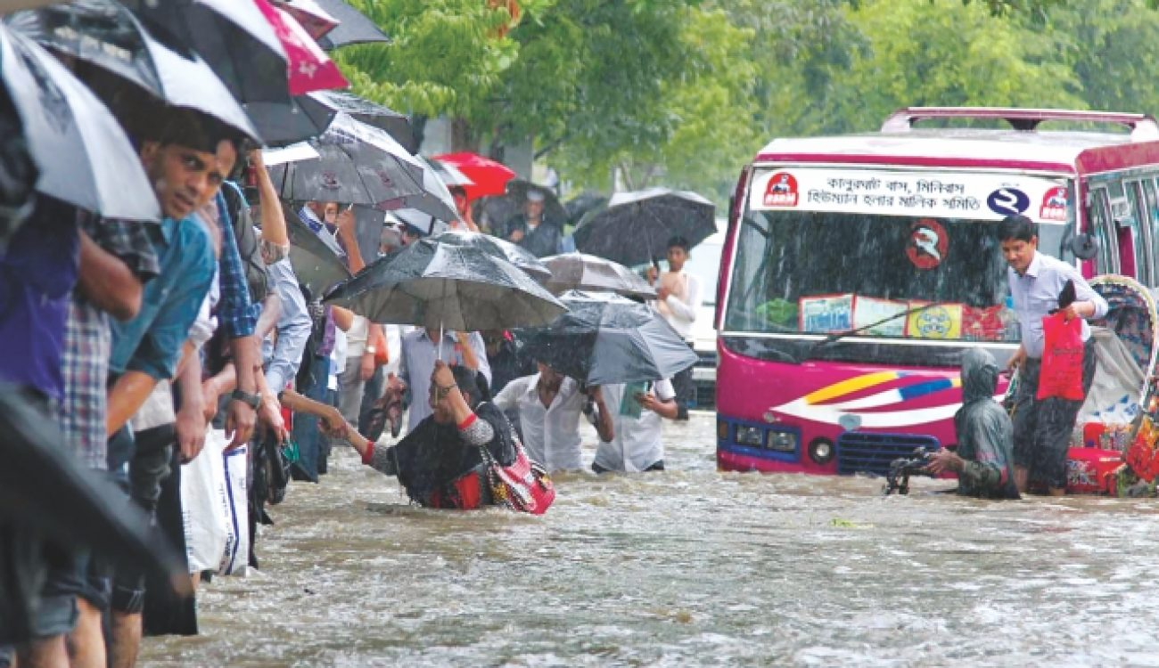 Heavy rain disrupts life in Dhaka city